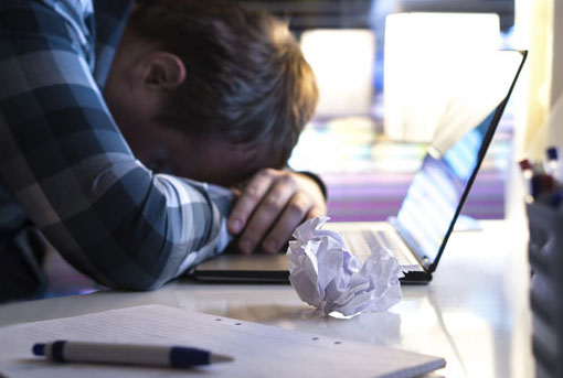 man-depressed-computer-slider